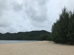"""On the left, the casuarina trees (""""ru"""" in Malay) that give the beach its name."""