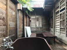 The outdoor bath has deck chairs too