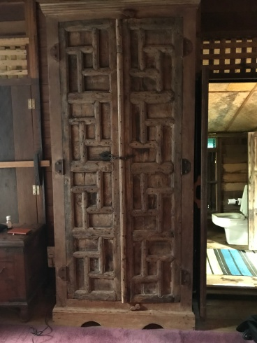 An antique wardrobe that looks like a medieval torture device